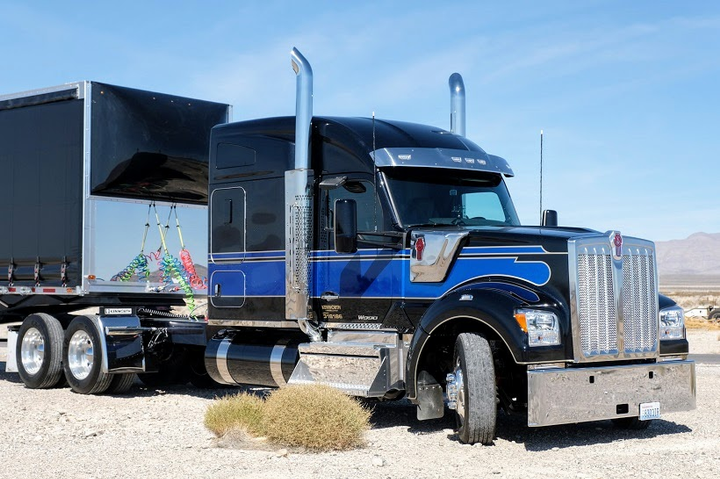 With a roomier cab, a bigger hood, lots of real stainless steel and aluminum trim along with very contemporary styling, the W990 is a capable contender for the top spot in the Kenworth stable.