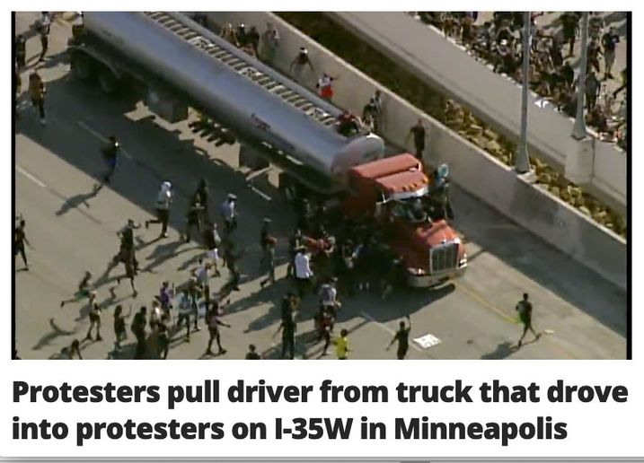 Even before the truck came to a stop, protesters started swarming it and pulled the driver from the cab.