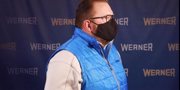 Werner CEO Derek Leathers demonstrates the proper way to wear a face covering -- over both the...
