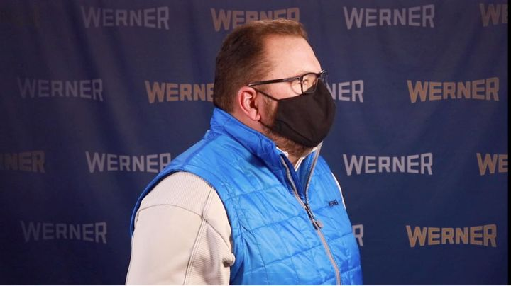 Werner CEO Derek Leathers demonstrates the proper way to wear a face covering -- over both the nose and mouth. - Werner video capture