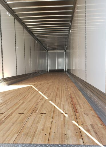 A composite floor reduces weight. Roof bows were rethought to provide more stability to the taller sides of the trailer. - Photo: Hub Group
