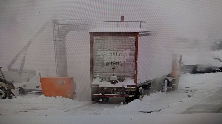 In a test last year, Henry Thissen's forced-air machine blows a 13-inch layer of snow off the roof of a van.  It'll also remove ice, its maker says.  Screen capture from Arctic Air video