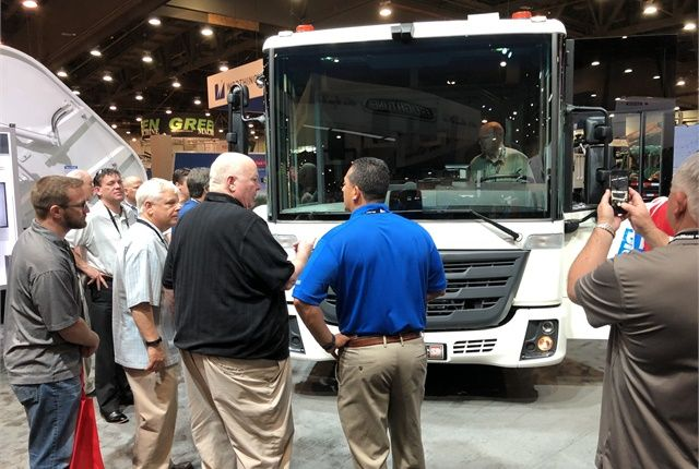 Refuse fleet professionals check out the new Freightliner EconicSD at its official unveiling at WasteExpo50 in Las Vegas. Photo: Jack Roberts