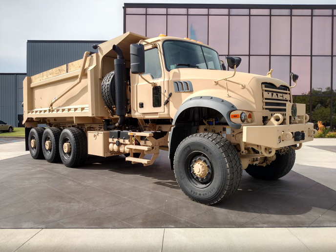 M917A3s are based on Mack's Granite vocational truck. Meritor tri-drive rear axles deliver constant traction on or off-road, and young soldiers need not be concerned with lift axles. Front-driving axle makes this an 8x8. Payload with the standard cab is 27 tons; an armored cab cuts that by 2.5 tons. GVW rating is 94,500 pounds.
