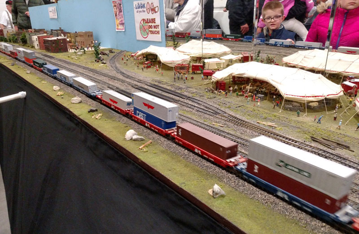 Containers have grabbed a large share of the intermodal freight business, and here's a miniature trainload of them at the model railroad show. Standardized sizes contribute to their efficiency, but containers visually vary only in color and markings so are aesthetically boring.  - Photo by Tom Berg