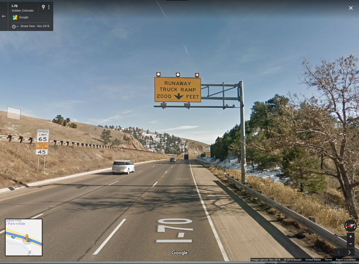 Speed limits for trucks over 30,000 lbs are posted at 45 mph. A sign advises drivers there's a runaway ramp 2,000 feet ahead.  - Google Earth screen capture
