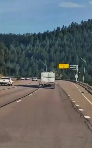 Screen capture from a video shot by a motorist of the alleged crash truck driving past a runaway ramp, minutes before the crash. -