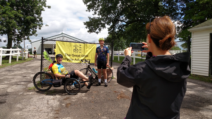 Two guys, just in from the last leg, 52 miles from Newark (Ohio) to Delaware, pose as a family member takes their picture. These people are in shape!