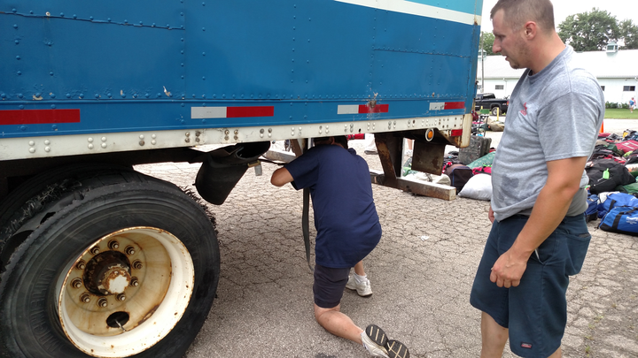 Shredded tire on the other trailer will roll home this way. Driver pulled the mudguard out of the way to keep it from being beaten to death by rubber shrapnel.  -