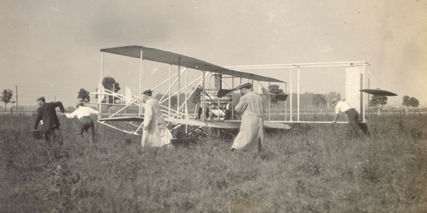 The Wright Brothers prepare for a flight over Huffman's Prairie, outside of Dayton, Ohio, circa...