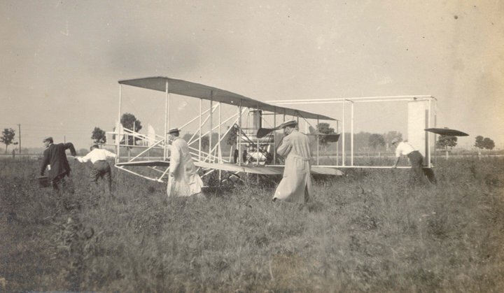 The Wright Brothers prepare for a flight over Huffman's Prairie, outside of Dayton, Ohio, circa 1906.