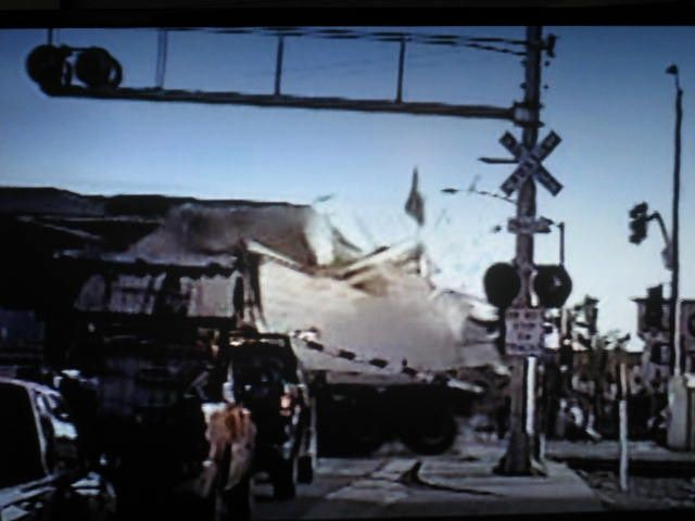 A trailer tends to explode and its contents scatter when hit by a super-heavy locomotive. And a tractor can be mangled.