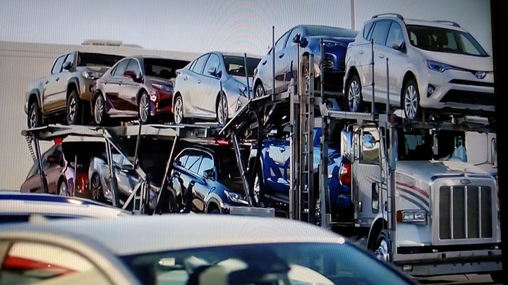 In a current commercial, an auto-hauling rig loaded with 2018-model cars and truck arrives at a Toyota dealer, ready for the big year-end sales event.