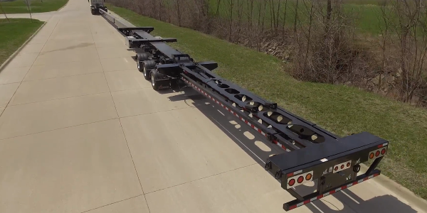 XL's Flip Extension adds 27 feet to an existing trailer to handle longer turbine blades without...