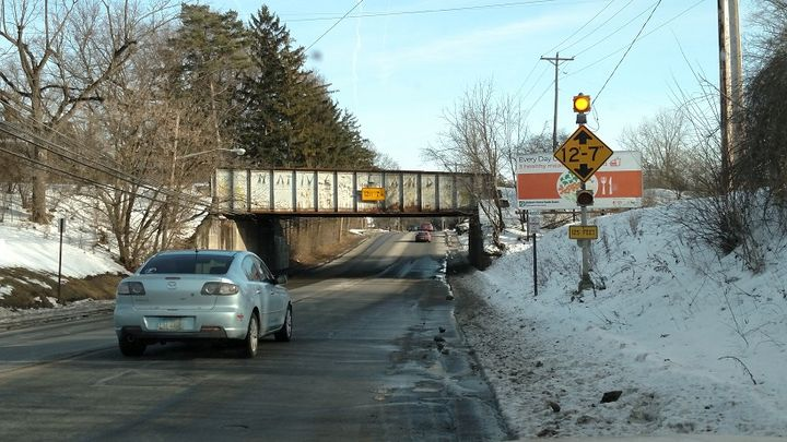 The low railroad bridge on West Central Avenue (State Route 37) in Delaware, Ohio, is getting a new laser-tripped warning system. But, would brighter LED lights on existing signs do the job as well?