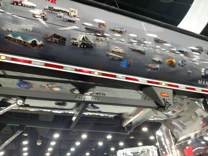 "At MATS, one exception to what seems to be the flatbeds-only-get-names rule was this Mac aluminum end-dump trailer whose subframe carried the painted-on moniker, ""Mac's I Mizer"" – apparently an unofficial play on a name used by a competitor.