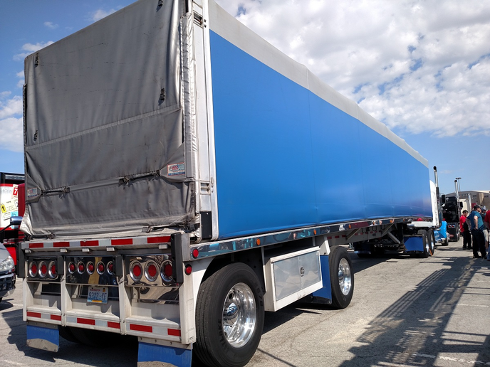 Long side curtain and mudflaps match the blue paint on the tractor hitched to this soft-sided trailer. They're common sights in the Midwest, though usually not as pretty as this one.