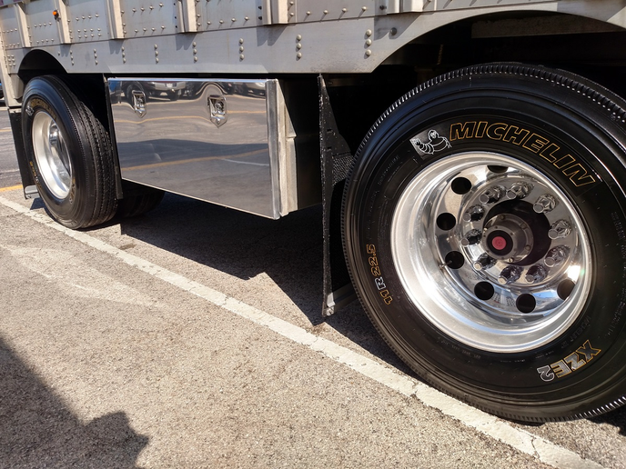 Someone with a lot of patience used paint pens to highlight lettering on these tires. Note the Michelin Man! They're on a Bennett livestock trailer.