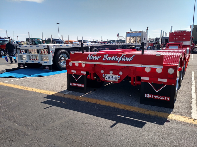 Even though they carry the payloads that allow truckers to make a living, trailers often don't pack much mystique for truckers. So mud flaps on these nice-looking lowboys advertise the brands of the tractors they're hitched to instead of the trailer makers.