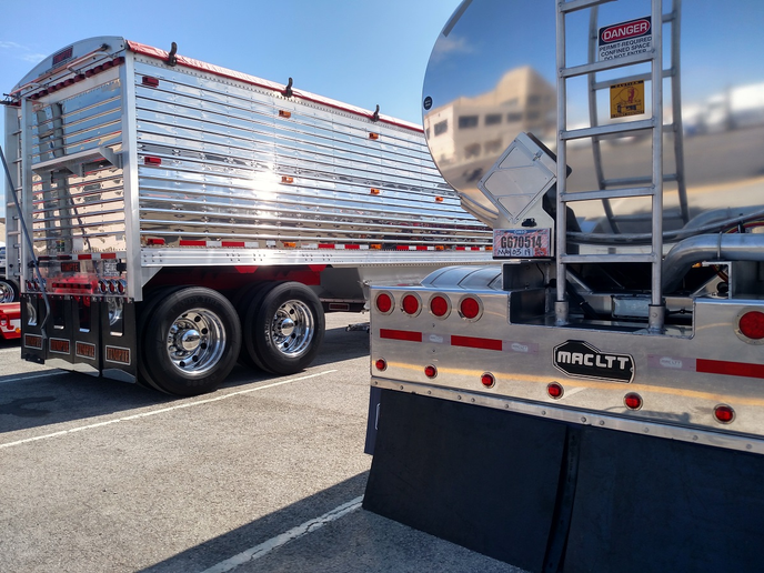 There's no doubt who made the highly polished grain hopper (left) and the tanker, among the many displayed at the truck beauty contest during the Mid-America Trucking Show in Louisville.