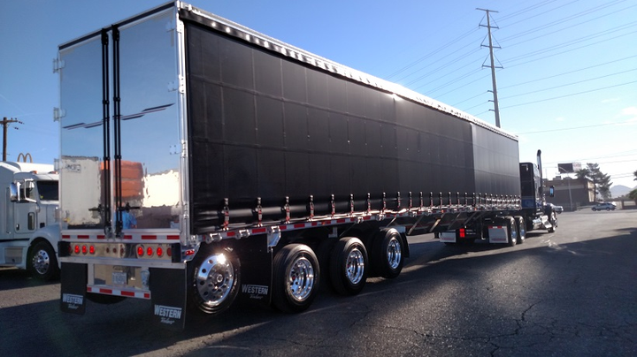 Liftable tag axle on this Western curtain-sider meets the wheels-back definition, so the trailer also needs only a simple bumper.  -