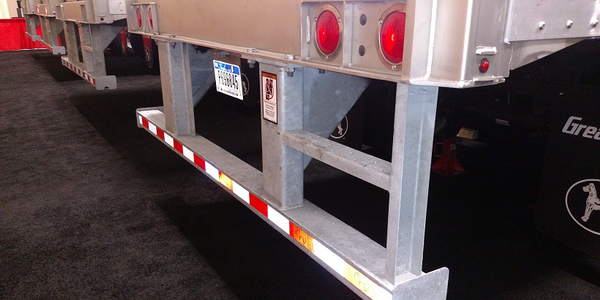 Rear impact guard on this van trailer complies with a 1998 federal safety standard that requires...