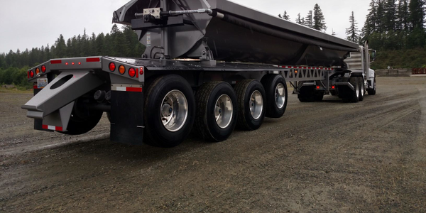 Side-dump trailers can do most of the things that end-dumps do, but are safer because their long...