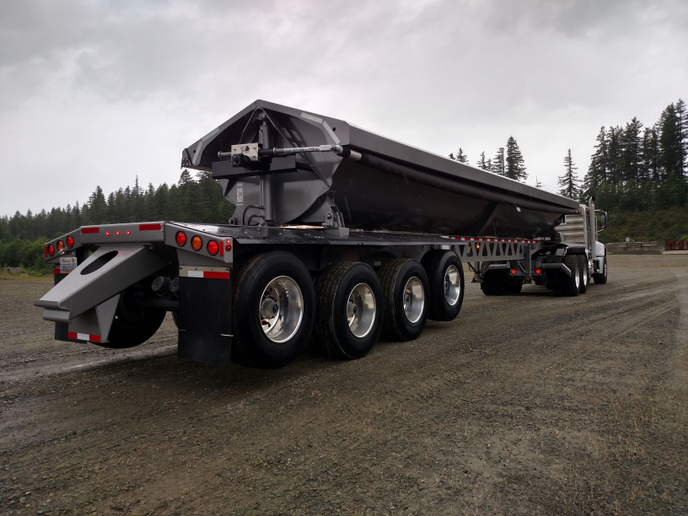 Side-dump trailers can do most of the things that end-dumps do, but are safer because their long bodies don't have to tip and usually quicker to unload, say people at Silver Streak Inc. in Washington state.