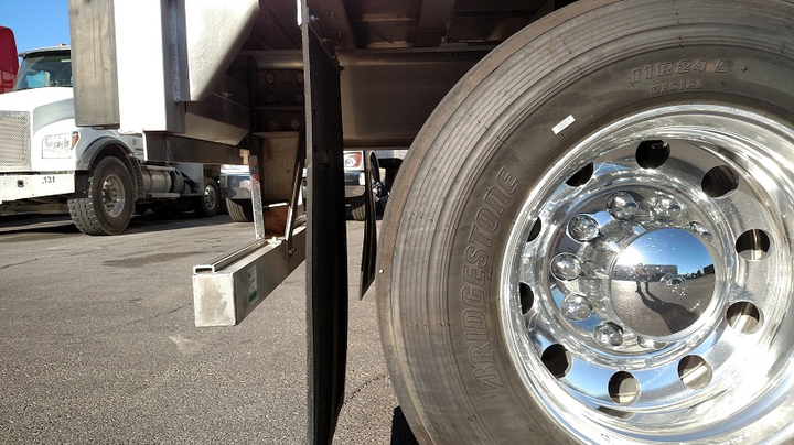 Livestock trailer's simple bumper meets the 1952 portion of the regulation. It would keep smaller and slower vehicles from under-riding the semi.  -