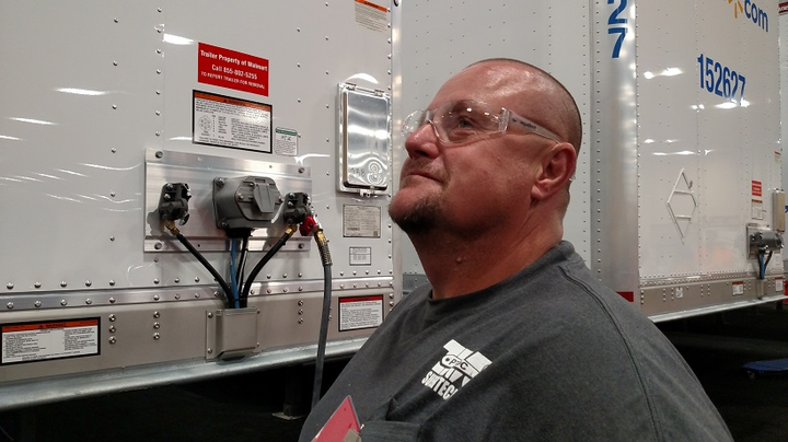 John Oswalt, a repair technician at a Love's Truck Stop in Columbus, Mississippi, is among competitors at the annual SuperTech event. He's got an apparent head cold, so might be more tired than others who are being judged on their problem-solving skills.