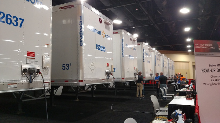 Brand-new Great Dane vans line one end of the testing hall at the TMC SuperTech competition in Orlando on September 17. Technicians must fix glitches placed in the vehicles by administrators. 