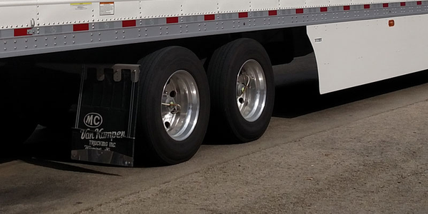 The inner dual on a trailer's rearmost axle is out of the driver's sight and farthest from him....