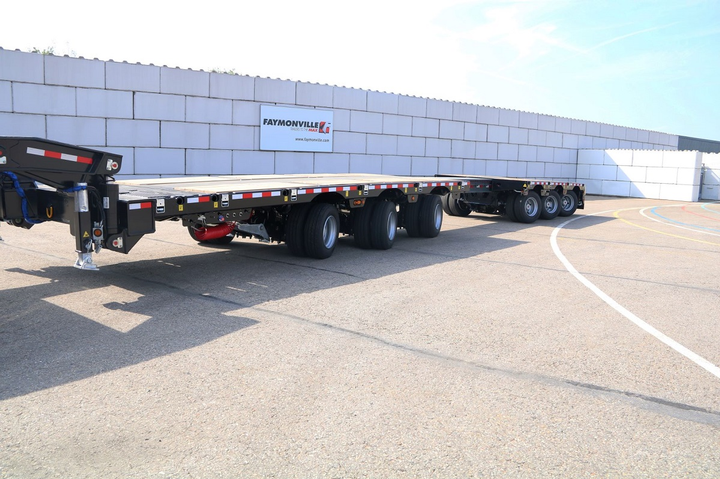 In tight turns, forward tridem caster-steers while the rear group counter-steers with a kingpin-geometry mechanism thaat can be remotely controlled, the builder says.  -