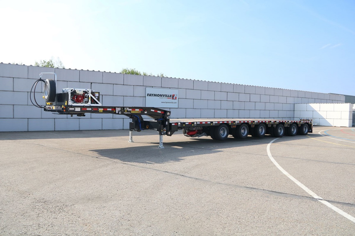 Except for its six axles, a closed-up MultiMax dropdeck looks fairly normal, and is a standard 53-foot length for transporting to a job site with no permits required.  -