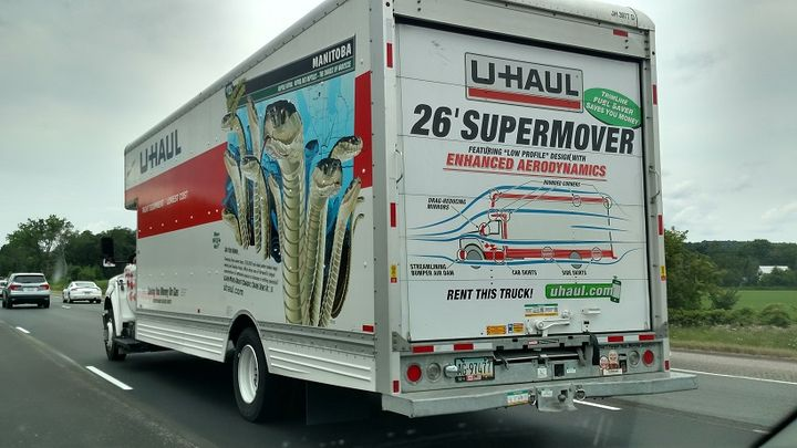 "Spotted on a highway in Ohio was this U-Haul ""Supermover"" with graphics boasting of the body's ""enhanced aerodynamics."" Arrows show air flow over curved corners front and rear.