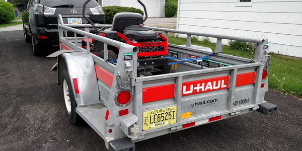 U-Haul 5x7 utility trailer has a low floor for easy loading. It's compact but very stout, with...