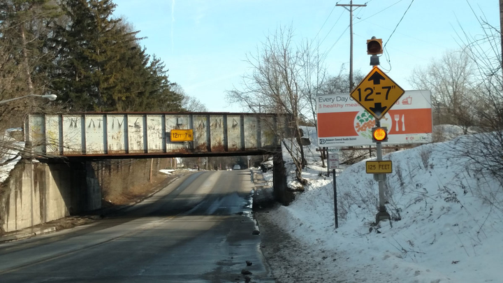 "This railroad overpass on Delaware, Ohio's West Central Avenue is known as the ""can opener"" for the many times it has peeled back the roofs of van trailers.