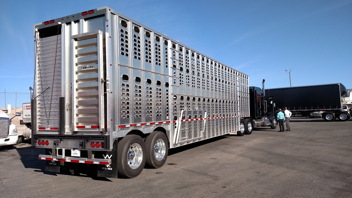 """Wilson livestock trailer is an example of a """"wheels back"""" type exempt from the shock-absorbing RIG requirement under 393.86 of the motor carrier safety rules. Its rearmost axle and tire-wheel assemblies would keep a car from riding under the trailer's structure, where its bumper covers most of the lateral area.  - Photos: Tom Berg"""