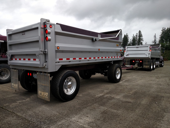 Fleet's latest pup configuration is this one, with two axles spread widely apart and big single wheels and tires. It's connected to a multi-axle truck by a long tongue, stretching overall axle distance to meet Washington state's bridge-formula regulations.