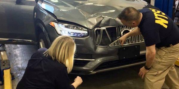 NTSB Investigators examine the Volvo XC90 sedan involved in a fatal crash on March 18, 2018,...