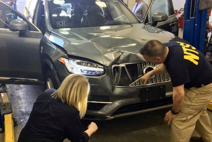 NTSB Investigators examine the Volvo XC90 sedan involved in a fatal crash on March 18, 2018, while under Uber autonomous control. - Photo: NTSB