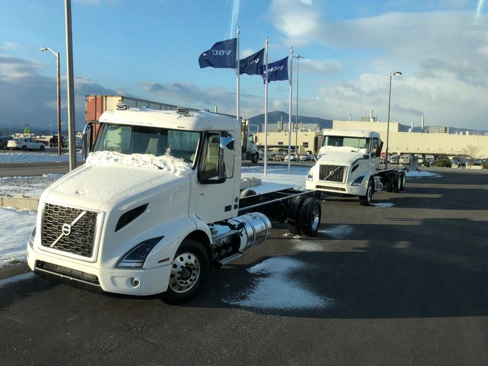 Volvo trucks on display at the entrance of the company's manufacturing plant in Dublin, Virginia. 