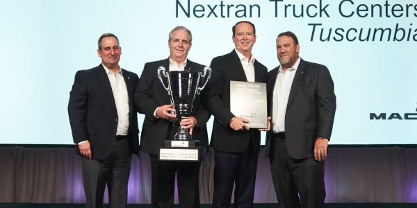 (Left to right) Martin Weissburg, president, Mack Trucks; Dennis McDaniel, regional vice...