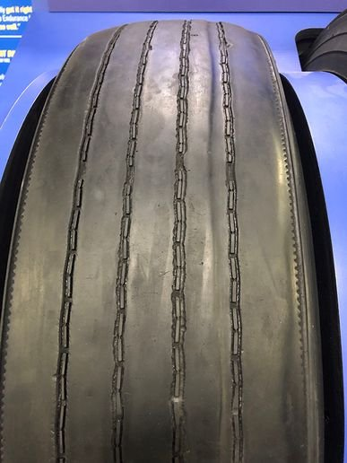 A Goodyear LHS steer tire removed from service at 233,950 miles is ready for it's next go-round as retreaded LHD drive tire. - Photo: Jim Park