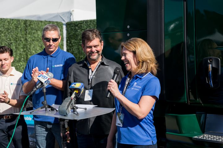 Executives from SoCalGas, Cummins Westport, the San Joaquin Air Pollution Control District, and Western Milling unveil new ultra-low emissions truck at World Ag Expo. - Photo: SoCalGas
