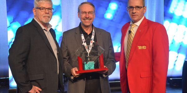 TMC Chairman Ken Calhoun and HDT Equipment Editor Jim Park present the awards to Stoneridge's...
