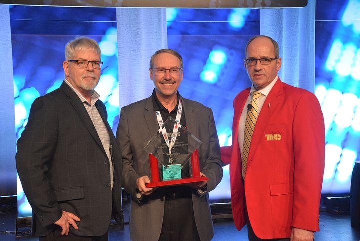 TMC Chairman Ken Calhoun and HDT Equipment Editor Jim Park present the awards to Stoneridge's Vice President of Business Development Stephen Fox. - Photo: TMC