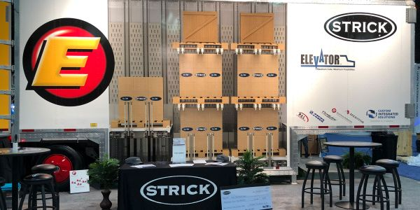 The Strick TMC display trailer featured graphics showing how three pallets could be stacked in...