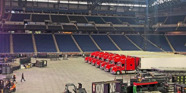 Upstage tractor-trailers at a concert venue in happier times.