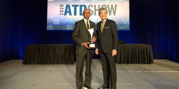 HDT Publisher David Moniz (right) was on hand at last year's ATD Show to award Oscar Horton,...